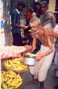 Taking bhiksha by a old aged sadhak