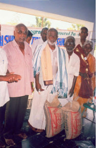 donating_ricebags_to_oldaged_people